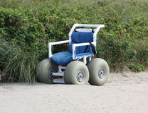 Wheel Chair for Beach Stock Photos