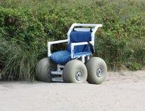 Wheel Chair for Beach. Handicapped Wheel Chair for Beach Stock Photos
