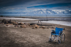 Wheel chair at the beach Royalty Free Stock Image