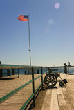 Wheel chair on dock. Empty wheel chair sitting on dock with American flag in background Stock Photo