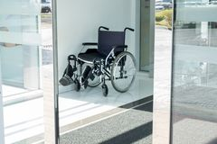 Wheel Chair at the door of Hospital entance royalty free stock images