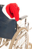 Wheel chair with hat Santa Claus Royalty Free Stock Photos