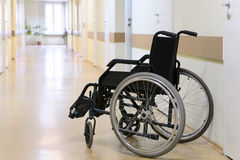 Wheel chair in the hospital corridor. Stock Photos