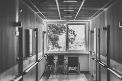 Wheel chair at the hospital corridor Stock Images