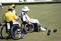 Wheel Chair Lawn Bowls for Disabled Persons (Men) Royalty Free Stock Photos