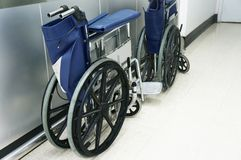 Wheel chair on the path in the hospital. Mobile devices for patients stock photography