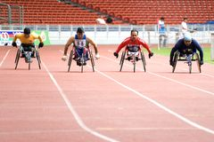 Wheel Chair Race. Image of disabled athletes competing in the men's wheel chair race event at the MAAU-MSN All-Comers Meet 2007, held at Kuala Lumpur, Malaysia stock photo