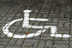Wheel chair sign. On the floor Royalty Free Stock Photo
