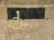 Wheel-Chair Sign. Wall detail Royalty Free Stock Photo
