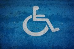 Wheel chair sign parking spot Royalty Free Stock Photography