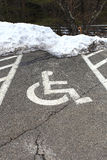 Wheel chair symbol in parking lot Royalty Free Stock Image