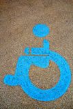 Wheel chair symbol on street Royalty Free Stock Photography