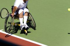Wheel Chair Tennis for Disabled Persons (Men). A wheel chair tennis player in action in an international tournament Royalty Free Stock Photo