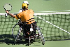Wheel Chair Tennis for Disabled Persons (Men). Wheel chair tennis players shaking hands after a game in an international tournament royalty free stock image