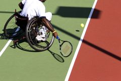 Wheel Chair Tennis for Disabled Persons (Men) Royalty Free Stock Photography