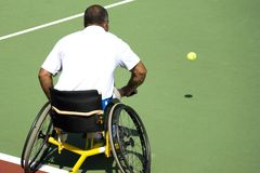 Wheel Chair Tennis for Disabled Persons (Men). A wheel chair tennis player in action in an international tournament Stock Image