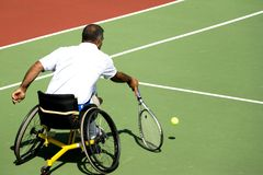 Wheel Chair Tennis for Disabled Persons (Men). A wheel chair tennis player in action in an international tournament Stock Images