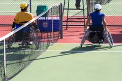 Wheel Chair Tennis for Disabled Persons (Women). Wheel chair tennis players finishing a game in an international tournament Stock Image