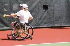 Wheel Chair Tennis for Disabled Persons (Women). A wheel chair tennis player in action in an international tournament Stock Photo