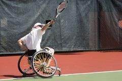 Wheel Chair Tennis for Disabled Persons (Women). A wheel chair tennis player in action in an international tournament stock photos