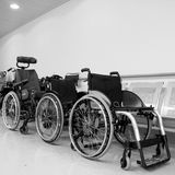 Wheel chairs. Parked in a hospital corridor stock images