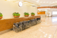 Wheel chairs at the airport for old age passengers assistance Stock Photo