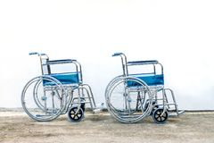 Wheel chairs standby for help a old people Royalty Free Stock Photos