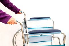 Wheel chairs standby for help a old people Stock Photos