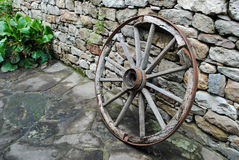 Wheel of chariot. The wheel of the chariot supported by a wall Stock Photos