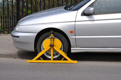 Wheel Clamp. Car with wheel clamp found somewhere stock photo