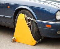 Wheel clamp. Attached to the wheel of a car royalty free stock image