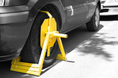 Wheel clamp. On a car parked illegal in no parking zone royalty free stock photos