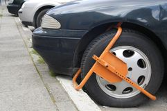 Wheel Clamp. Clamped front wheel in restricted area Royalty Free Stock Image