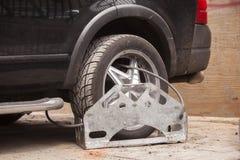 Wheel clamp. Car Stock Photo