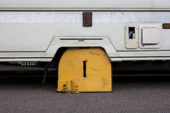 Wheel clamp on a caravan Stock Photo