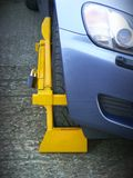 Wheel Clamp front. Wheel Clamp on illegally parked vehicle royalty free stock images
