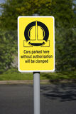 Wheel clamping sign Royalty Free Stock Images