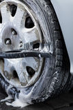 Wheel cleaning on a car wash Royalty Free Stock Photography
