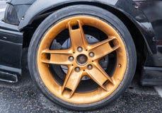 Wheel close up, golden colour rim, car tuning stock photo