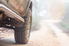 Wheel closeup in a countryside landscape with a muddy road, Off-. Road travel on mountain road,Adventure Travel, Rainy Season stock images