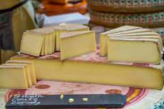 Wheel of Comte Cheese cut in Wedges Royalty Free Stock Images