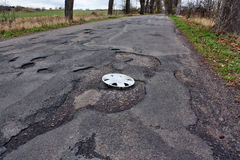 Wheel cover clipped on the damaged road Stock Image