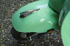 Wheel cover of a motor scooter. View from above to wheel and cover of a mint green vintage motor scooter Stock Photography