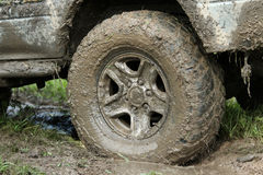 Wheel covered with mud Stock Photo