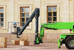 wheel cradle outriggers and levers with hydraulic lift heavy equipment machine that works near the palace Royalty Free Stock Image