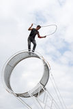 Wheel of death performer. A stunt performer performing a skipping rope while on top a wheel of death or a space wheel circus apparatus. This was performed during Royalty Free Stock Photography