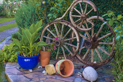 Wheel decoration on the flowerbed ii Royalty Free Stock Photos