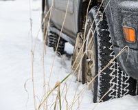 Wheel in deep winter snow snowbank Royalty Free Stock Photo