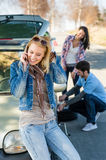Wheel defect man helping two female friends Stock Photo
