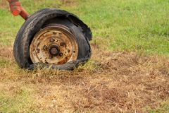 Wheel of destroyed agricultural machinery. Free space to write royalty free stock photo